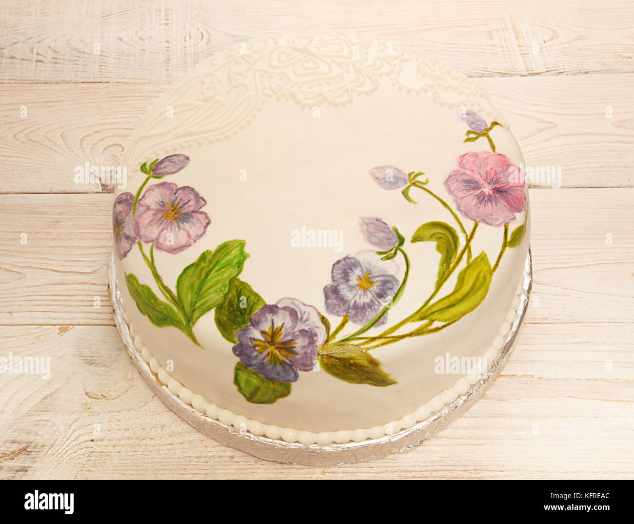 Painted cake fondant with food coloring. Cake with painted viola ...