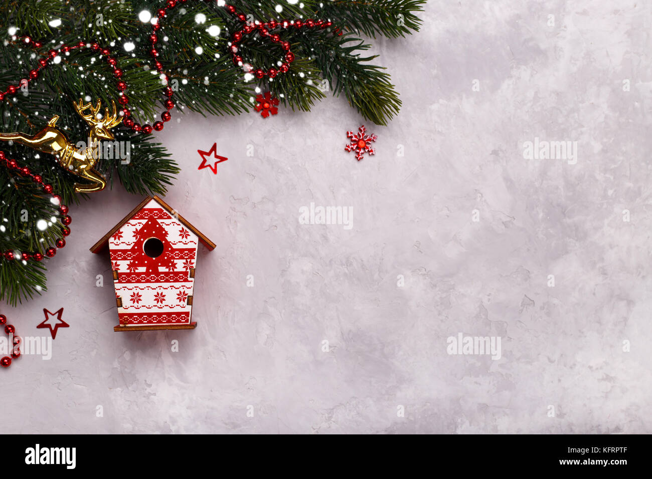 Birdhouse on pine tree branch,Christmas or new year greeting card ...