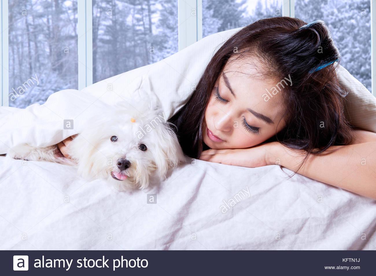 Sleeping bed winter stock photos sleeping bed winter for Sleeping with window open in winter