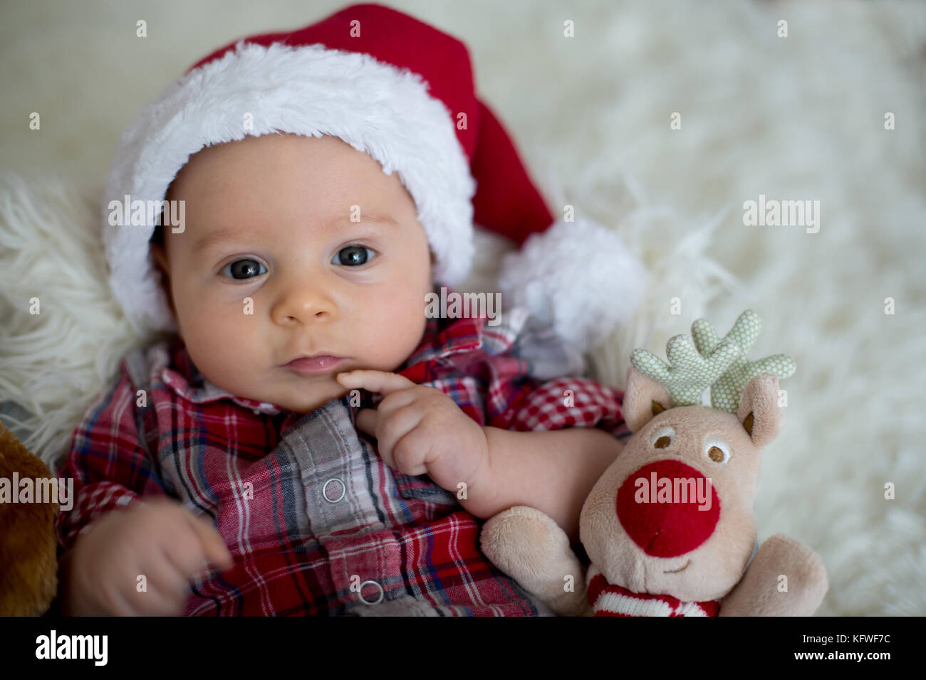 Christmas portrait of cute little newborn baby boy, dressed in Stock ...