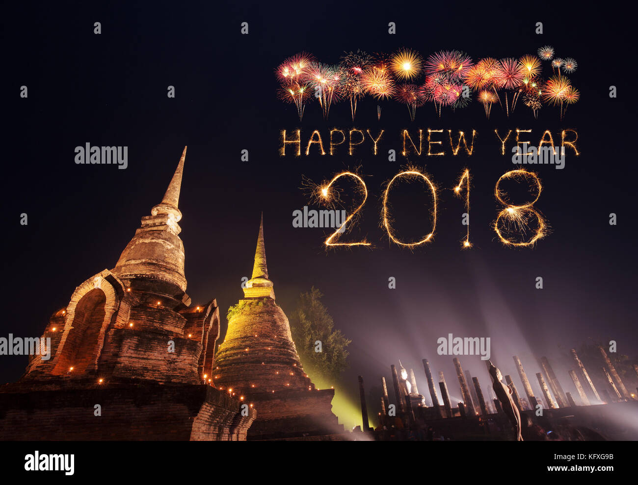 2018 happy new year firework sparkle with sukhothai historical park at night thailand