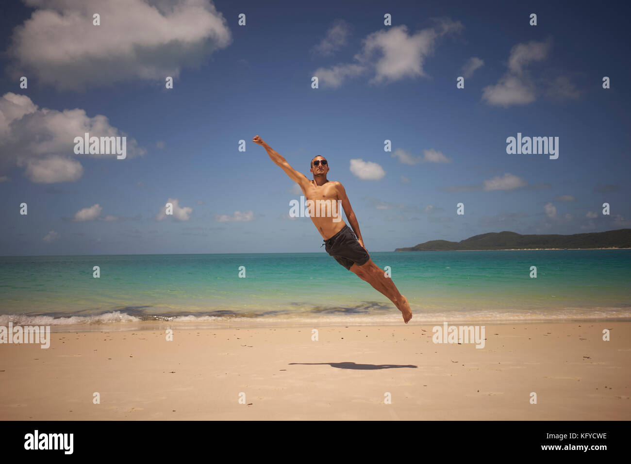 Man flying like superman stock photos man flying like superman young man in sunglasses is flying like a superman on the beach in the air publicscrutiny Images