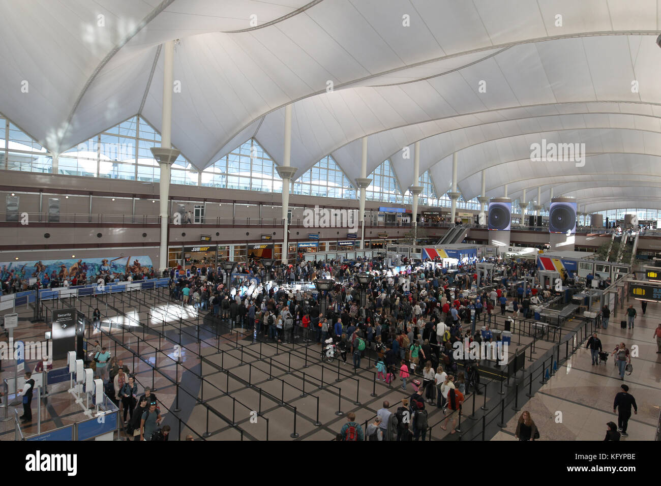 Security Checkpoint Of Denver International Airport Showing Roof That  Resembles The Rocky Mountains.   Stock