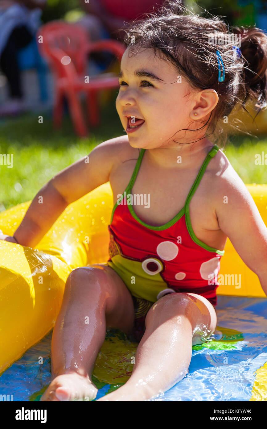 Kid backyard pool stock photos kid backyard pool stock for Baby garden pool