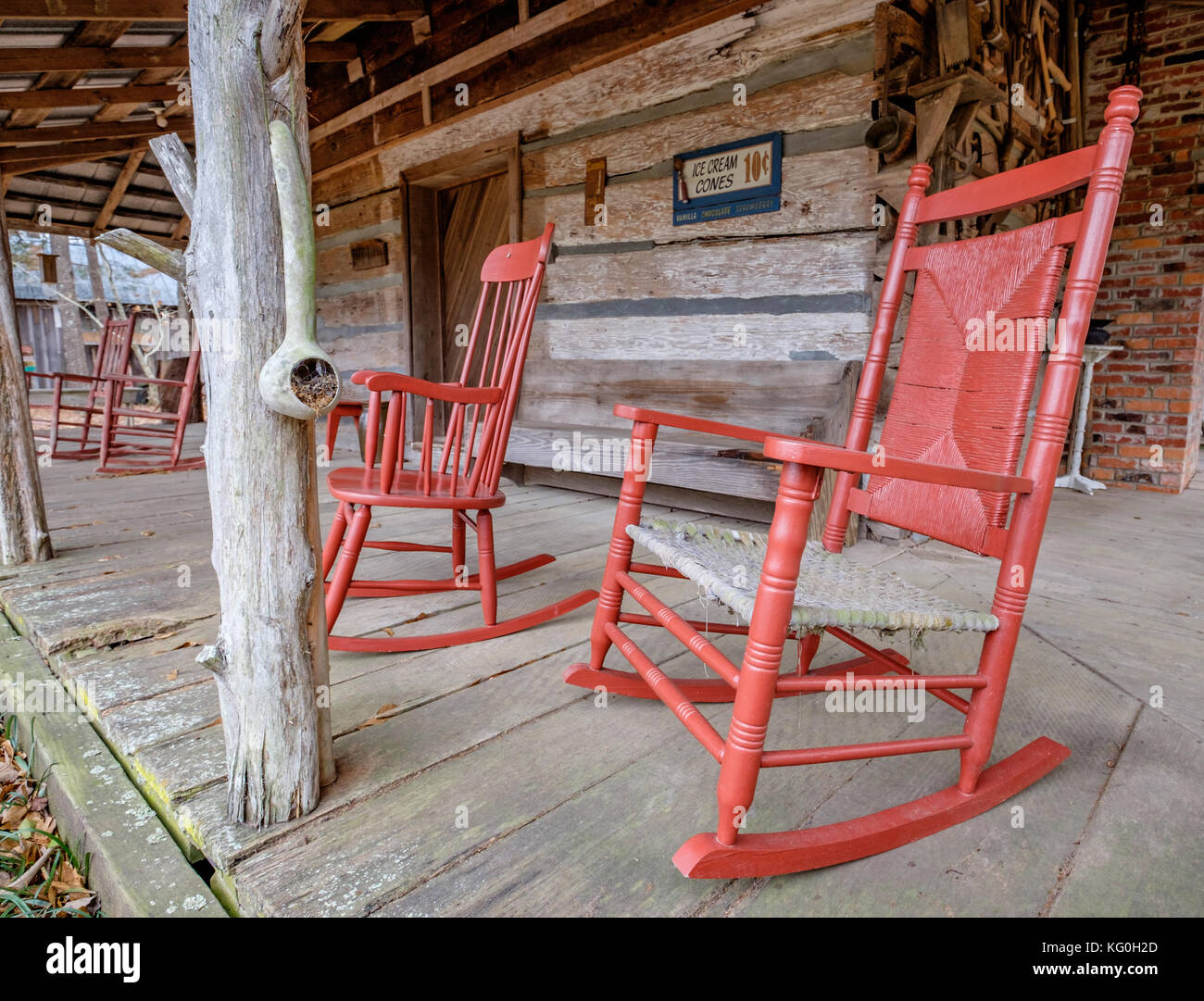 Old Fashioned White Rocking Chairs On The Front Porch Of An Old Cabin In  Rural Alabama, USA