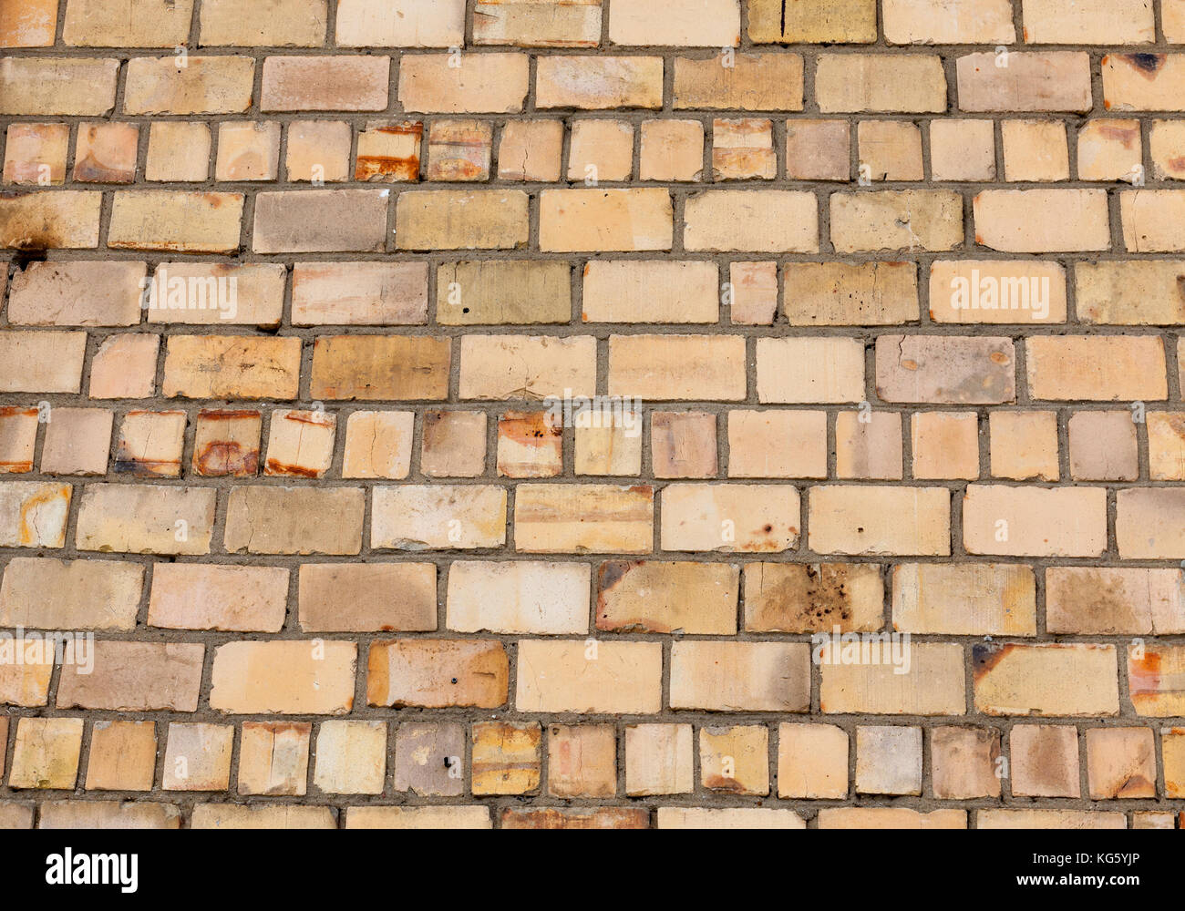 Plain wood table with hipster brick wall background stock photo - Yellow Brick Wall Stock Image