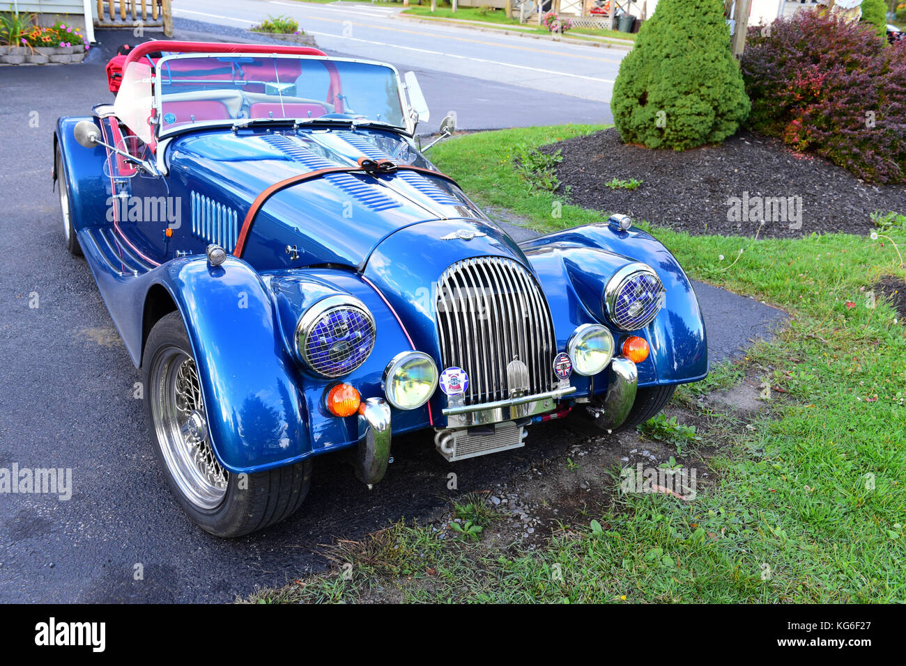 Symbol of power and prestige stock photos symbol of power and classic morgan plus 8 sports car in a parking lot stock image buycottarizona