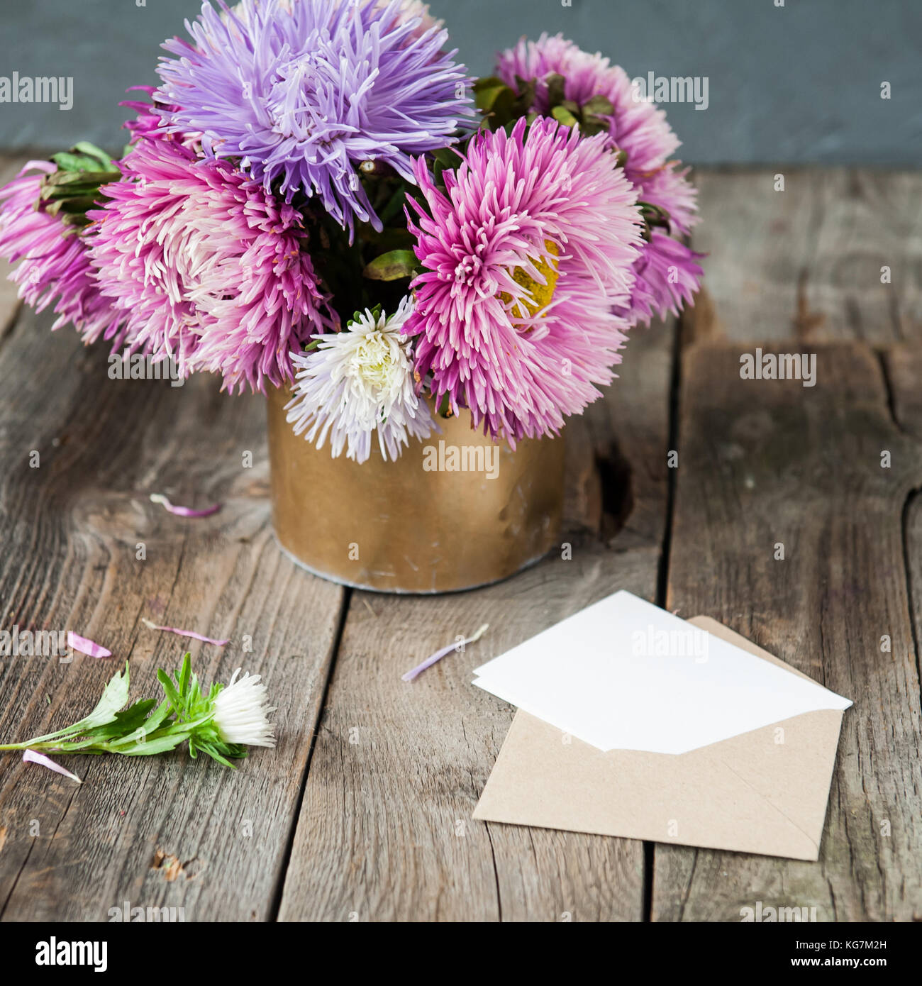 Multicolor aster flowers bouquet blank white greeting card and multicolor aster flowers bouquet blank white greeting card and craft paper envelope on rustic wooden table and dark grey background postcard mock u izmirmasajfo