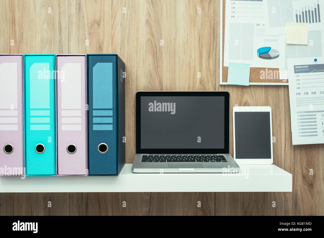 office pinboard. office pinboard. laptop and folders on a shelf in the office, pinboard background,