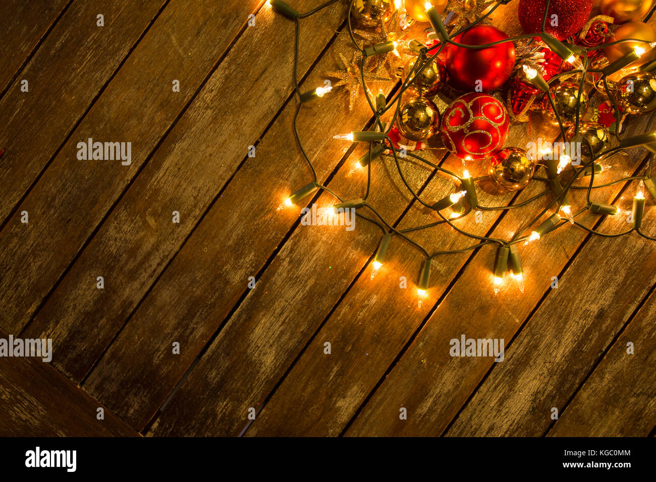christmas new year fairy lights on a wooden table to be used as background or texture