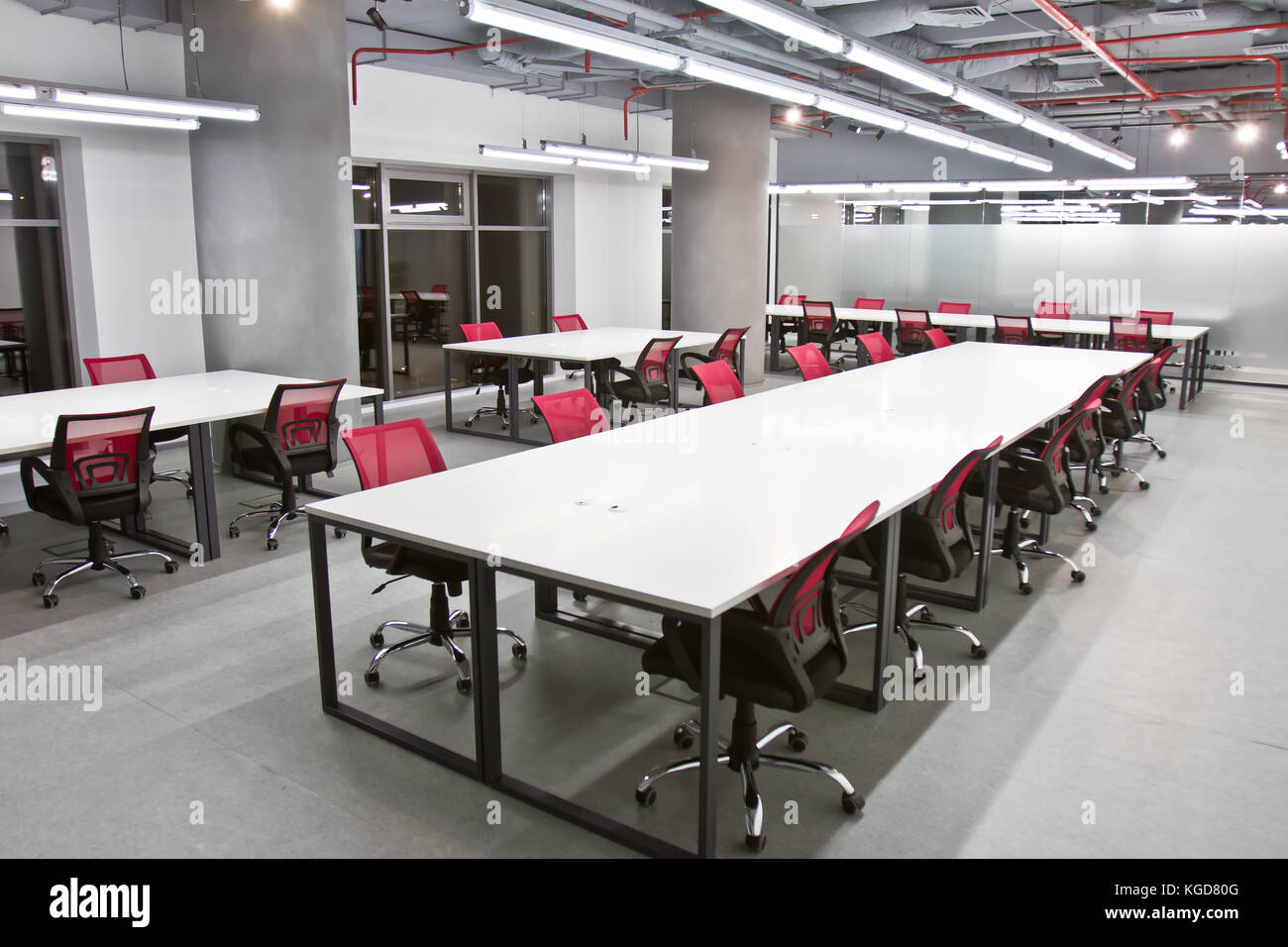 Luxurious Office Space With Large White Tables And Chairs And Modern - Large white conference table