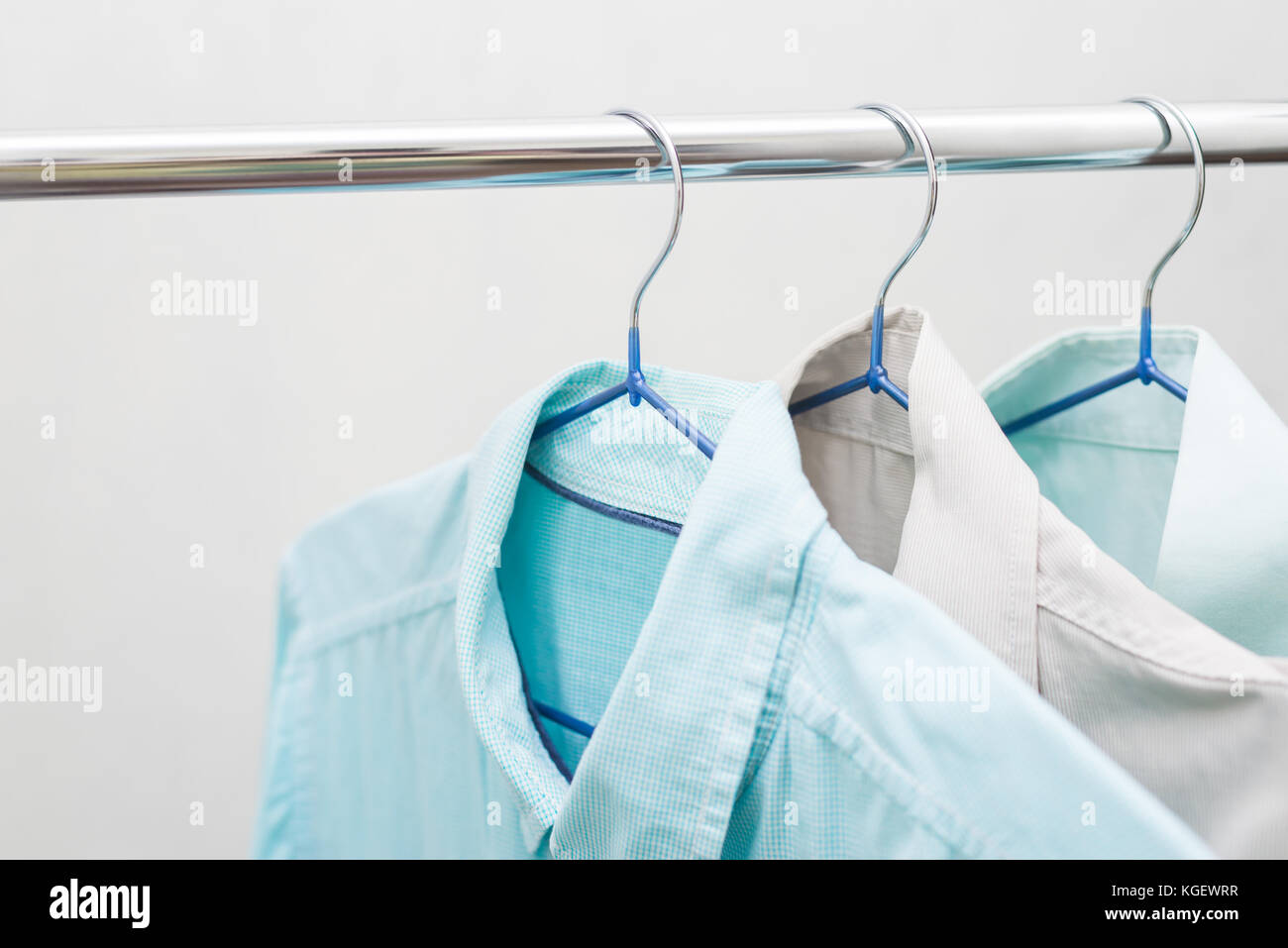 Blue Shirts On Hangers Hanging On A Pipe Stock Photo 165055403 Alamy