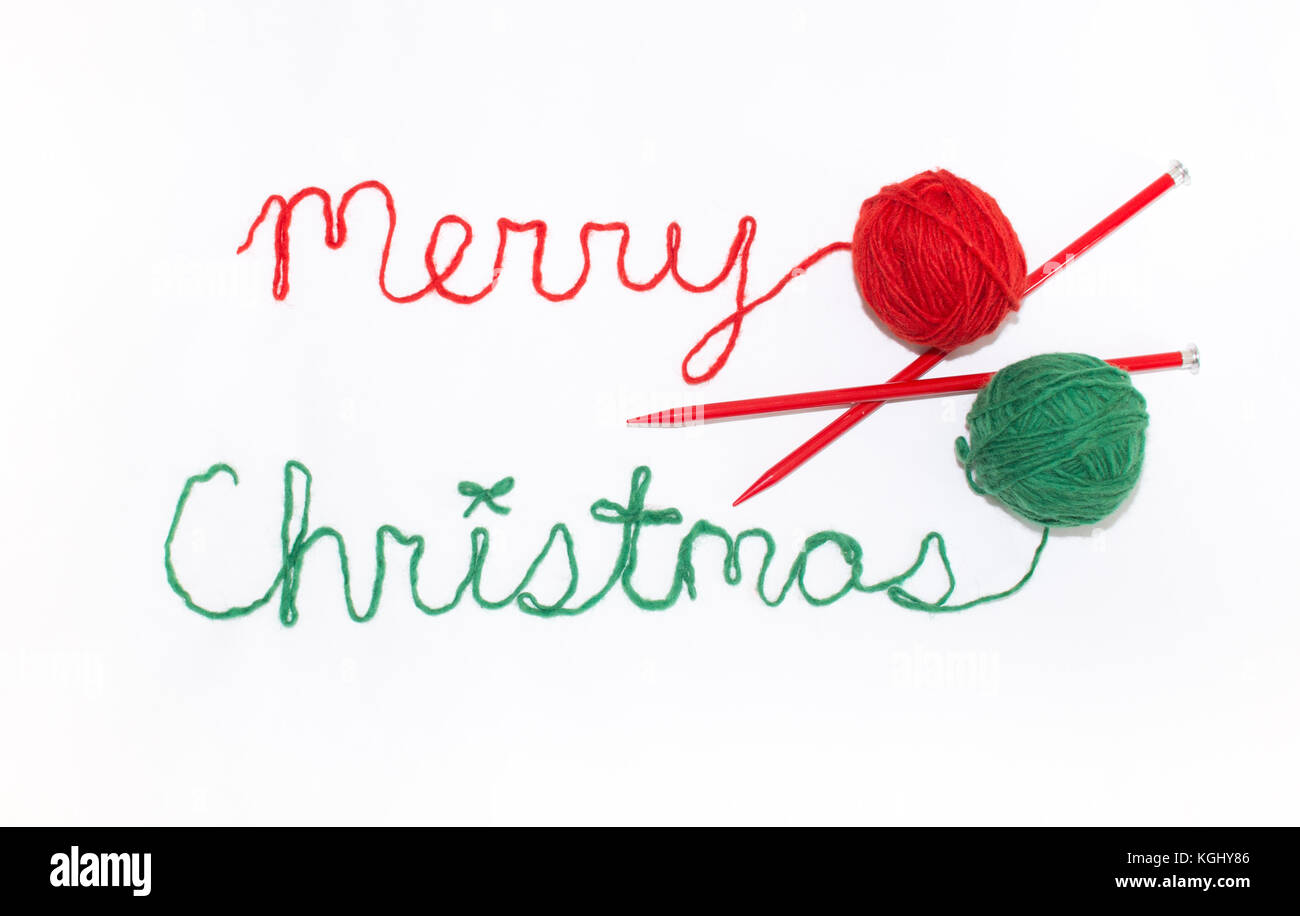 merry christmas written in cursive with red and green yarn and stock