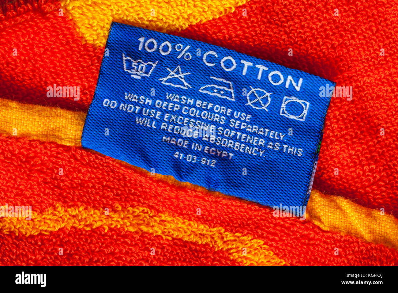 100 Cotton With Care Wash Symbols Label On Beach Towel Made In