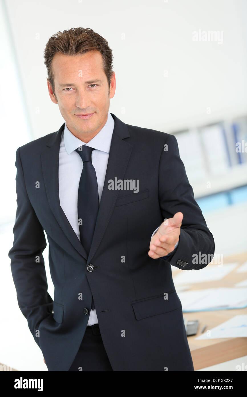 businessman in dark suit making business presentation stock photo, Powerpoint templates