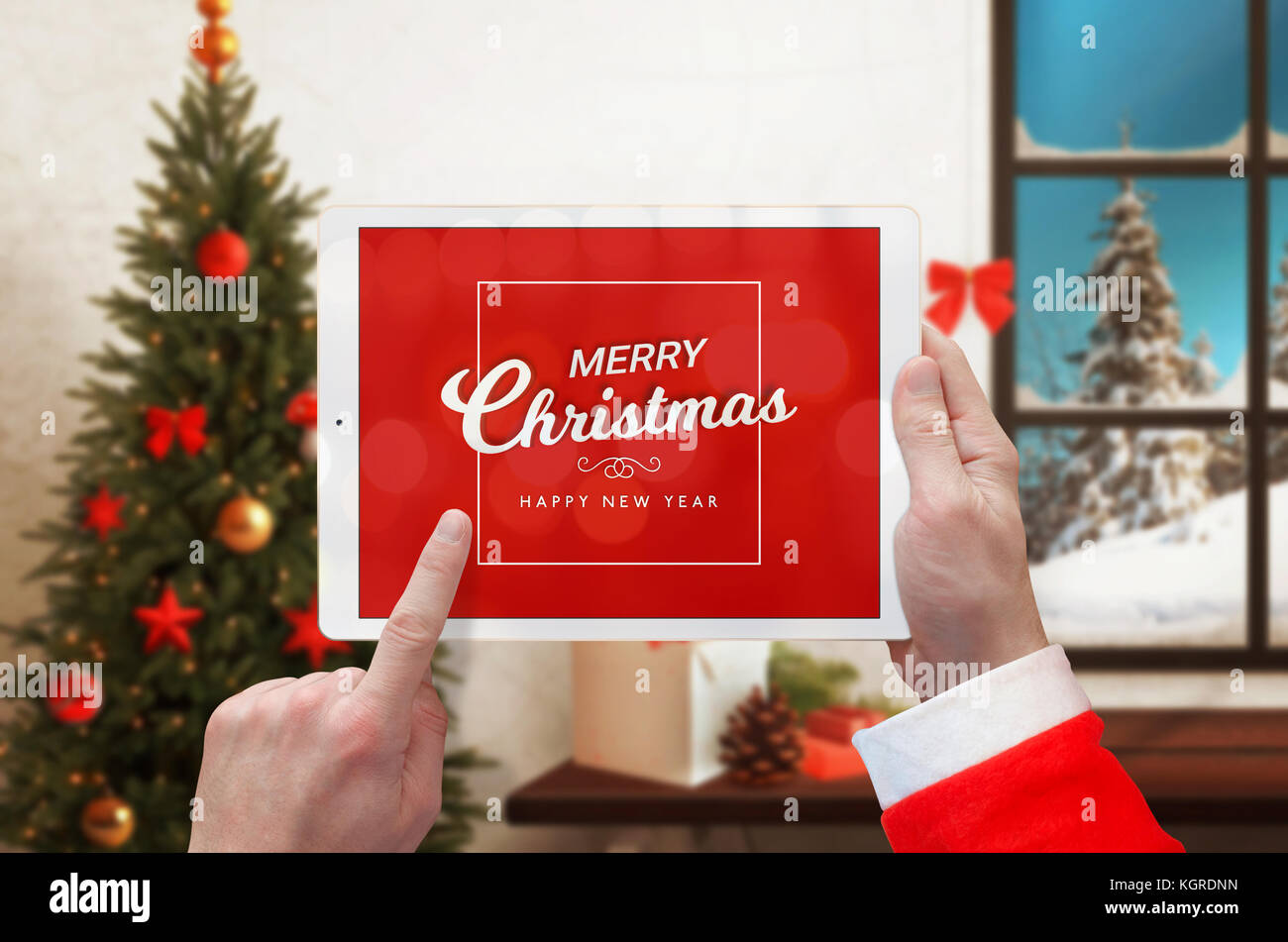 Merry Christmas and Happy New Year massage on white tablet in Santa ...