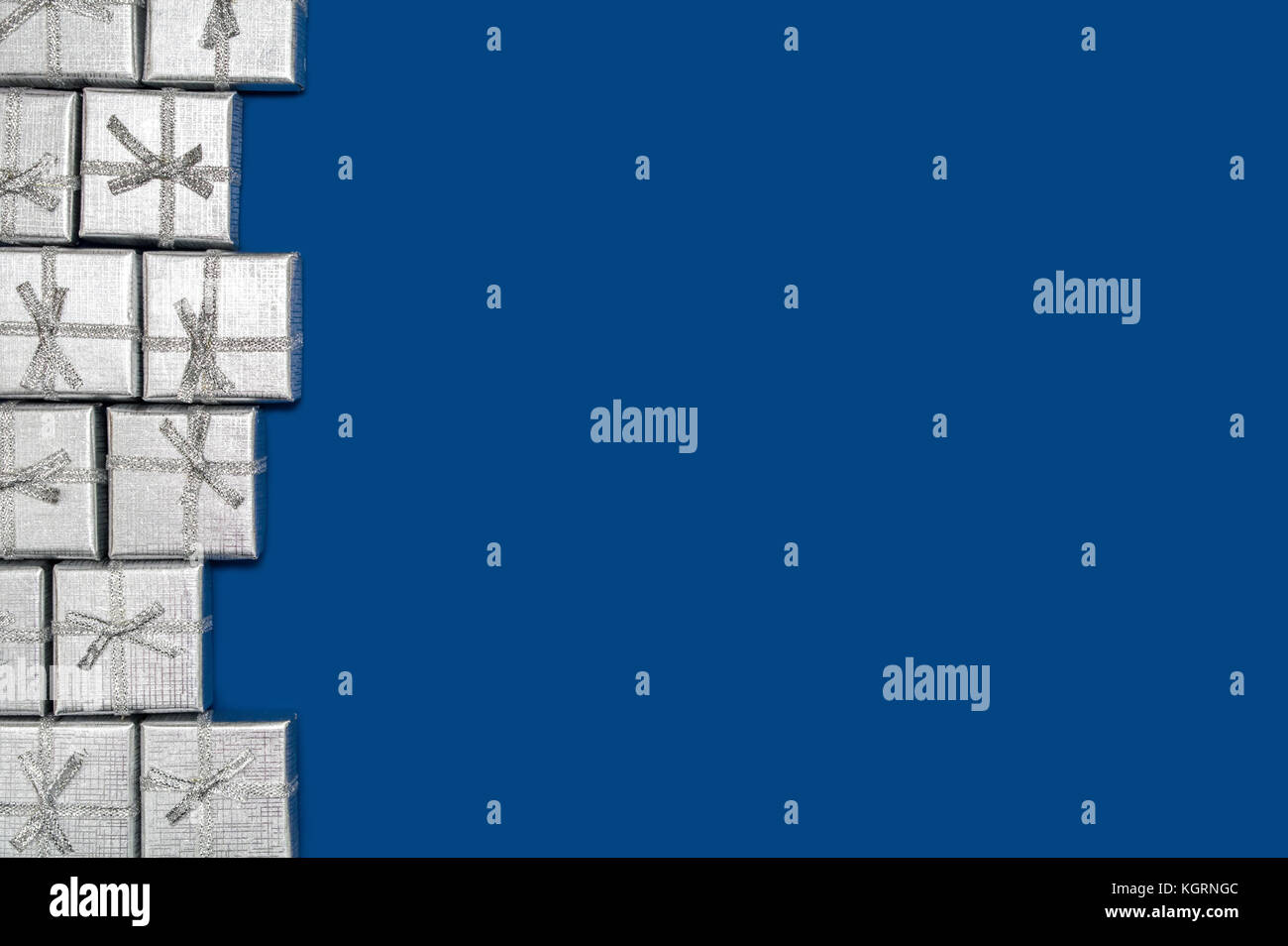 border of silver shiny gifts on blue background new year s and