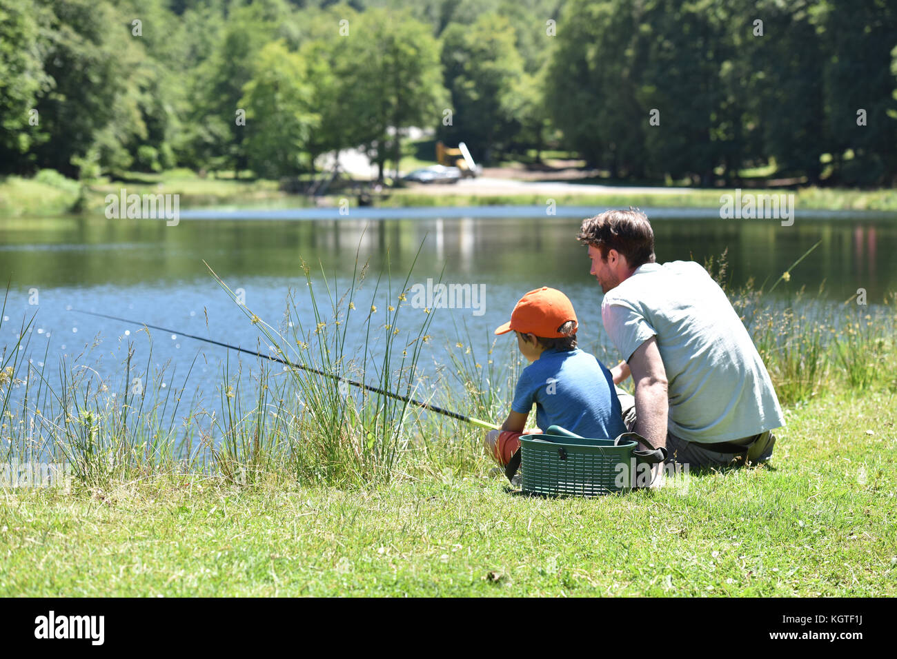 Little boy fishing dad stock photos little boy fishing for Little boy fishing