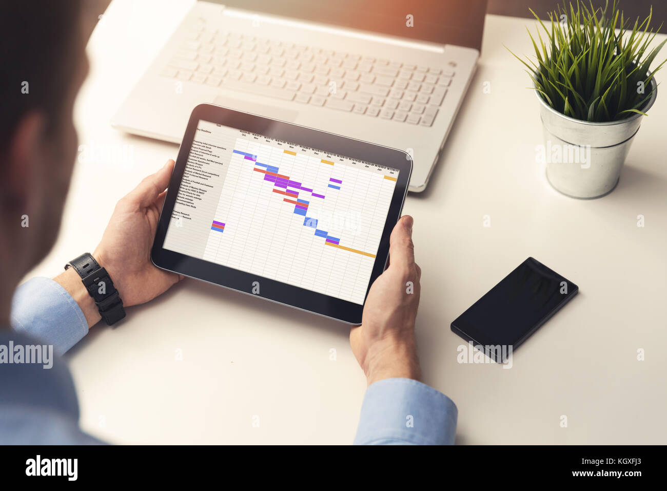 Gantt chart stock photos gantt chart stock images alamy project manager looking at gantt chart on digital tablet in office stock image nvjuhfo Choice Image