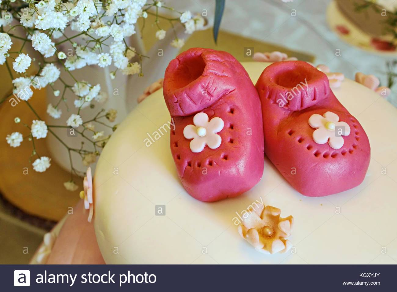 Pink Marzipan Baby Booties On A Baby Shower Cake For A Girl To Stock