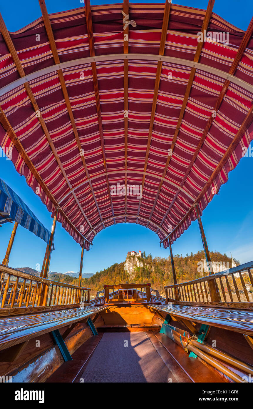 Bled, Slovenia   Traditional Wooden Red Canvas Roof Pletna Boat At Lake  Bled On A