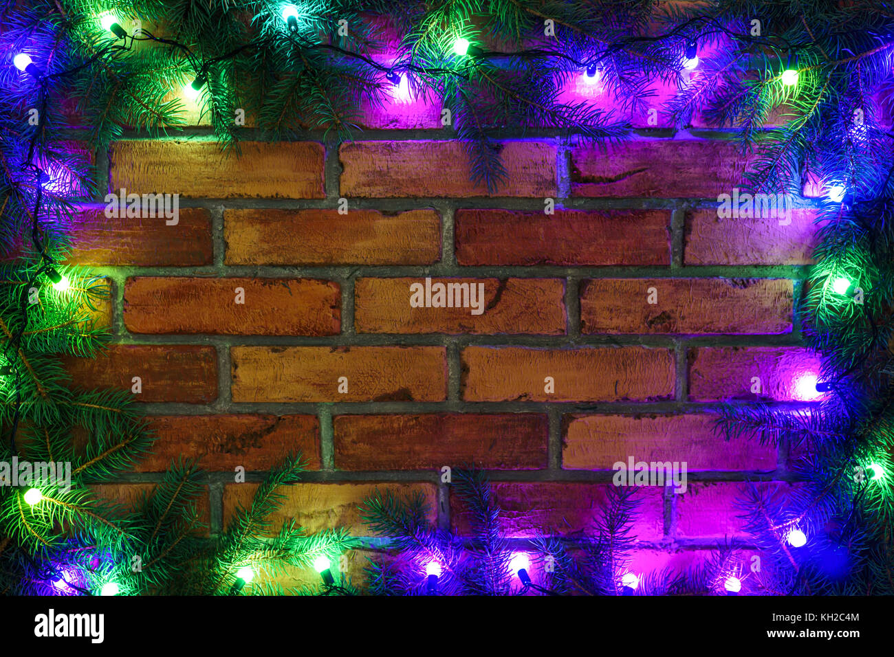 wreath and garlands of colored light bulbschristmas background with lights and free text space christmas lights border glowing colorful christmas l