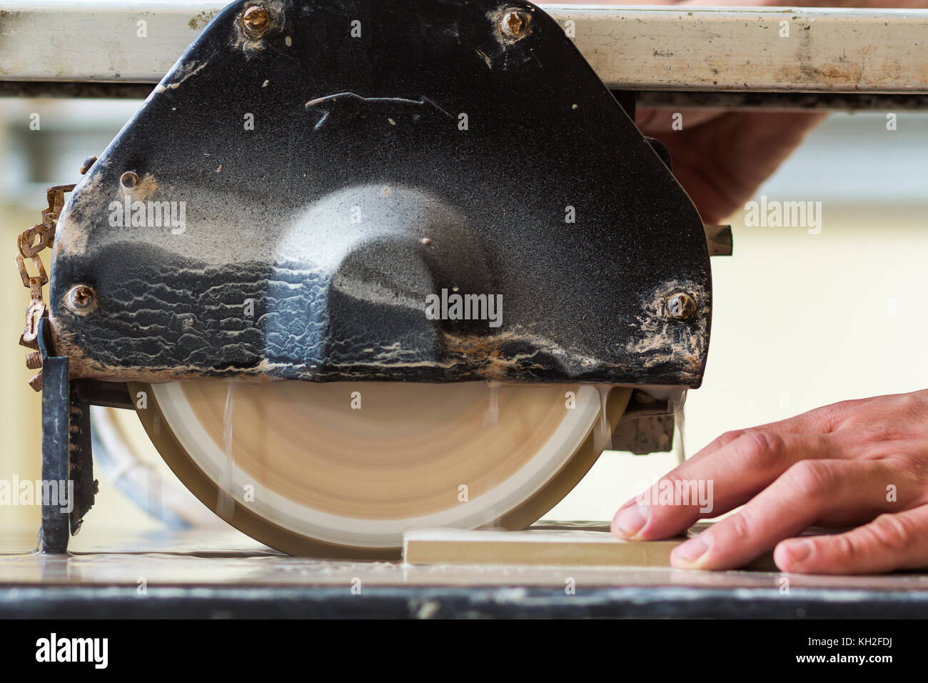 Worker Hand Cutting Ceramic Tile With Water Cutting Machine Close Up