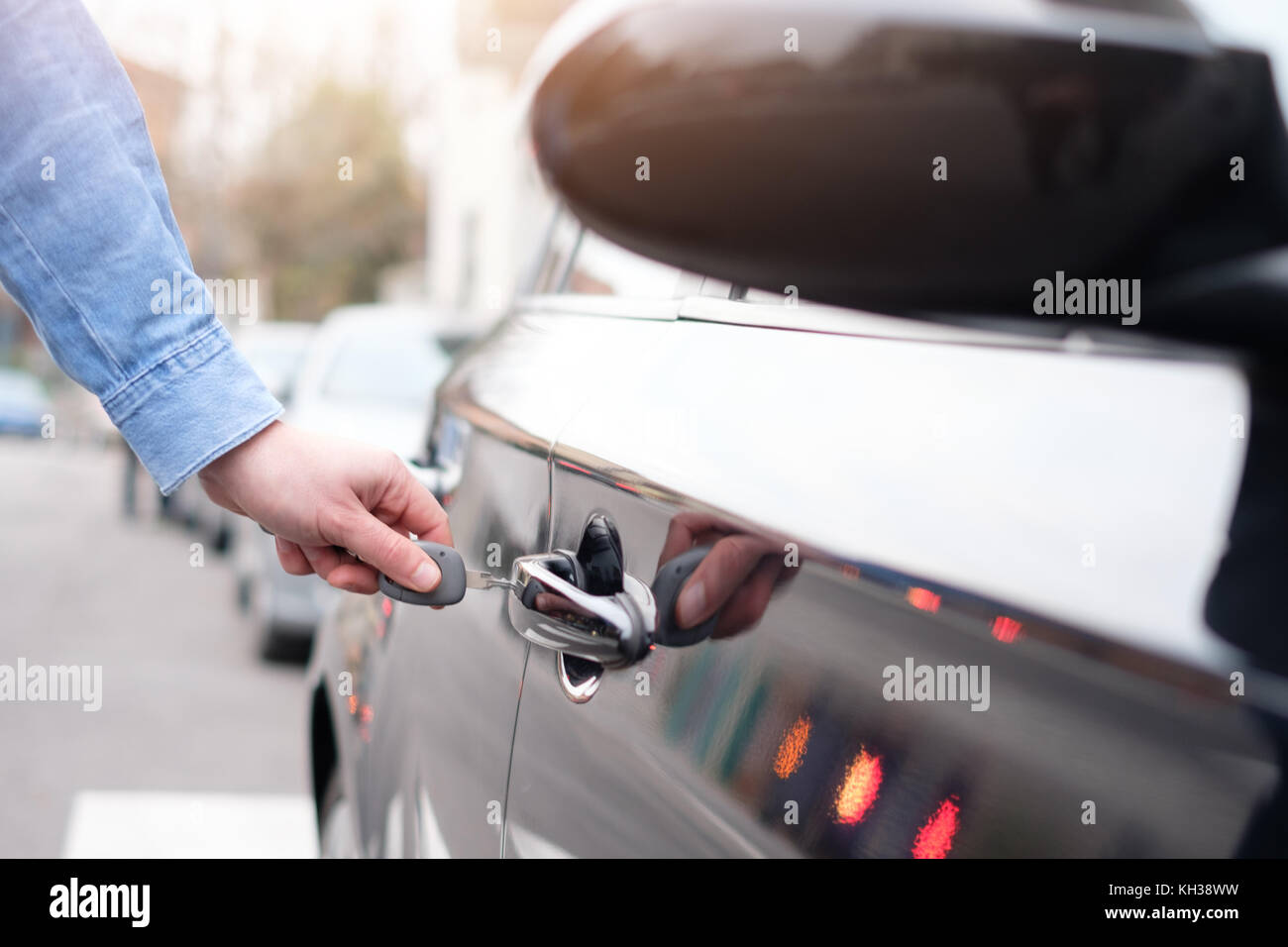 Hand Holding A Car Key And Opening The Car Door Lock Stock Photo