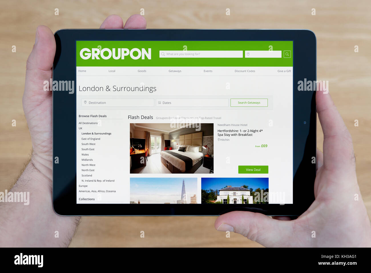 Groupon logo stock photos groupon logo stock images alamy a man looks at the groupon website on his ipad tablet device shot against a buycottarizona Image collections