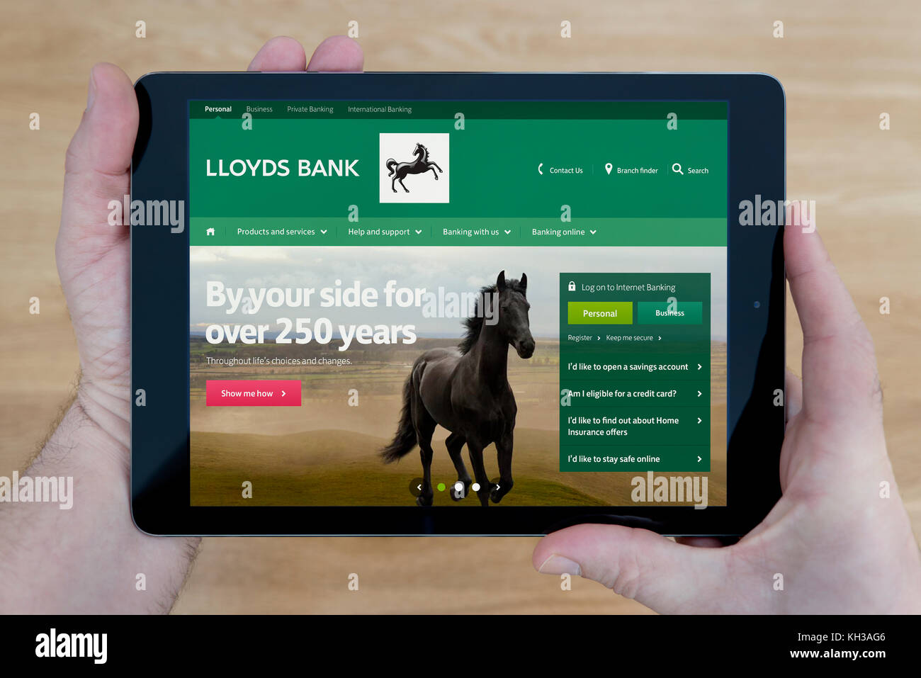 Lloyds bank app stock photos lloyds bank app stock images alamy a man looks at the lloyds bank website on his ipad tablet device shot against magicingreecefo Image collections
