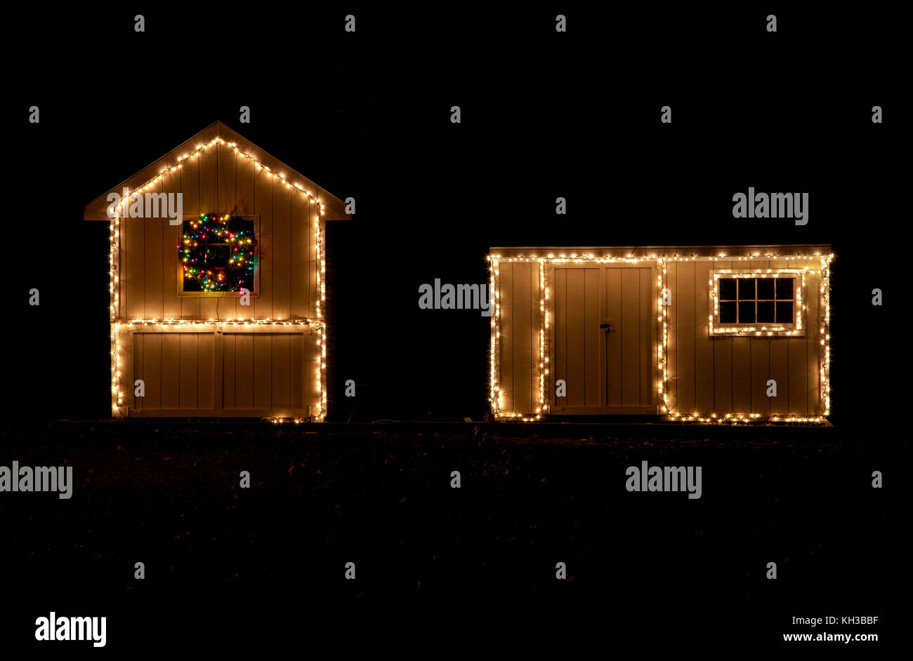 christmas lights at night on two small garden sheds new jersey usa