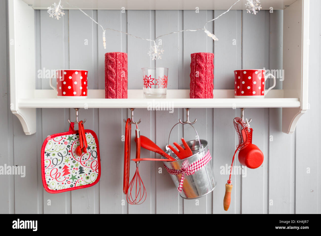 shelves with dishes. Interior light grey kitchen and red christmas ...