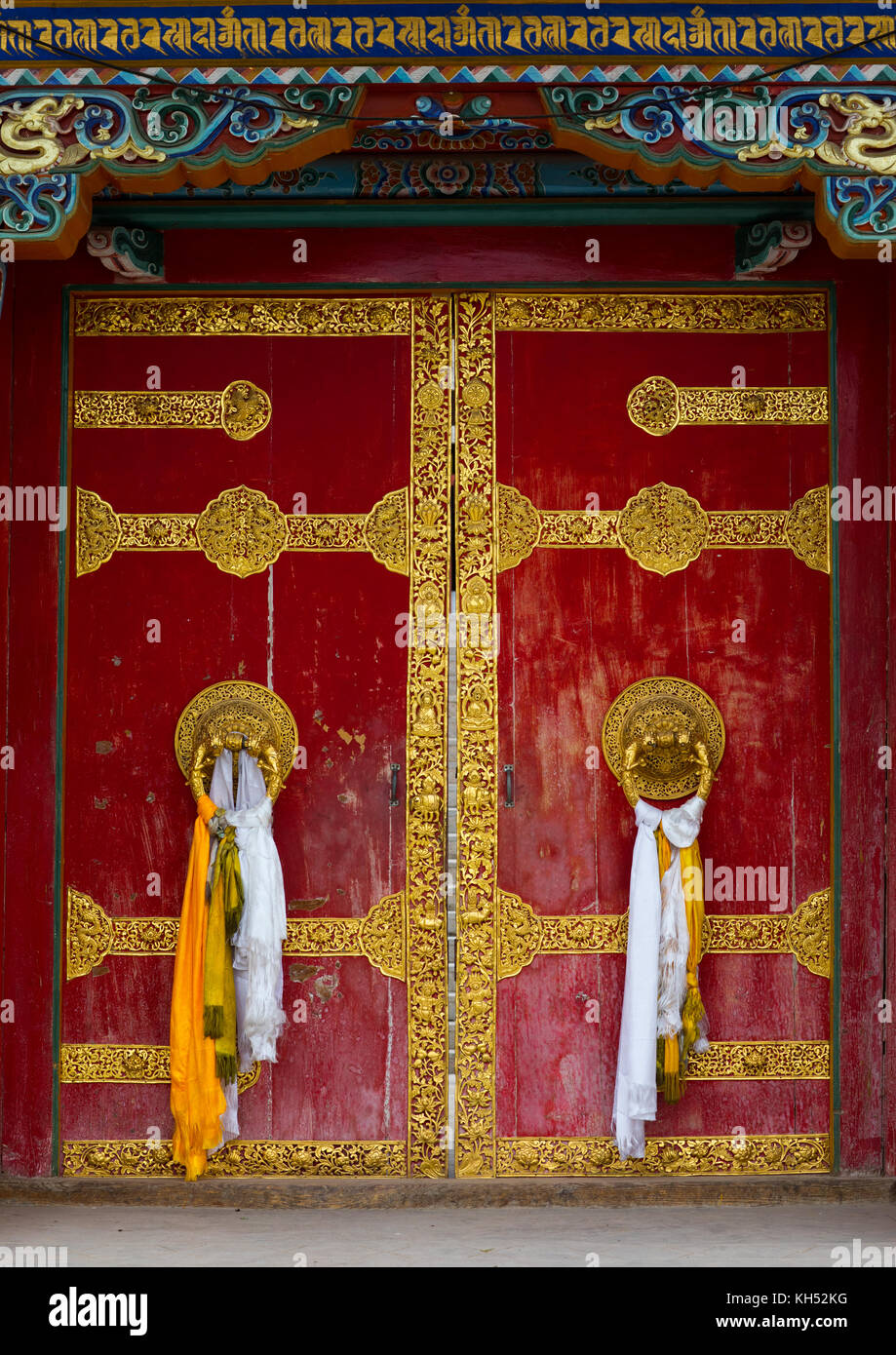 Ornate knockers on traditional buddhist door temple in Hezuo monastery Gansu province Hezuo China & Ornate knockers on traditional buddhist door temple in Hezuo Stock ...