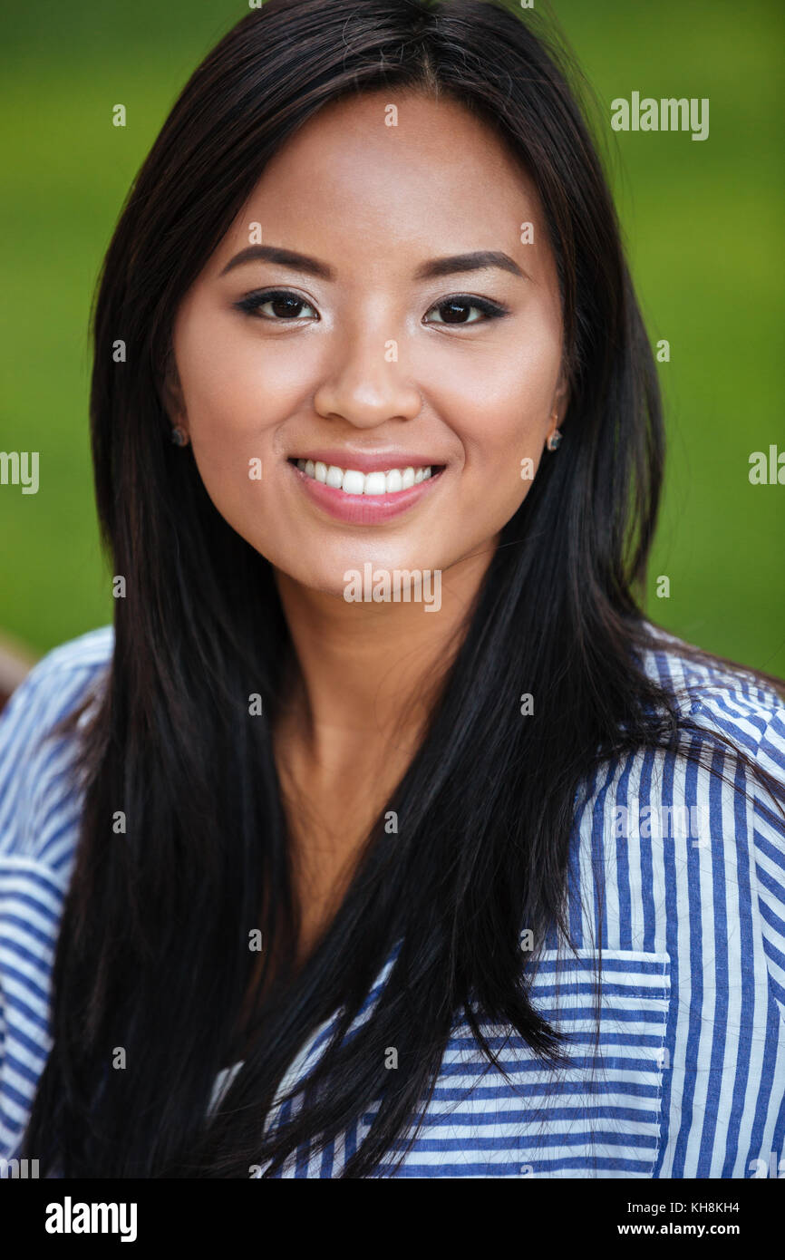 Close Up Portrait Of An Attractive Smiling Asian Woman With Long