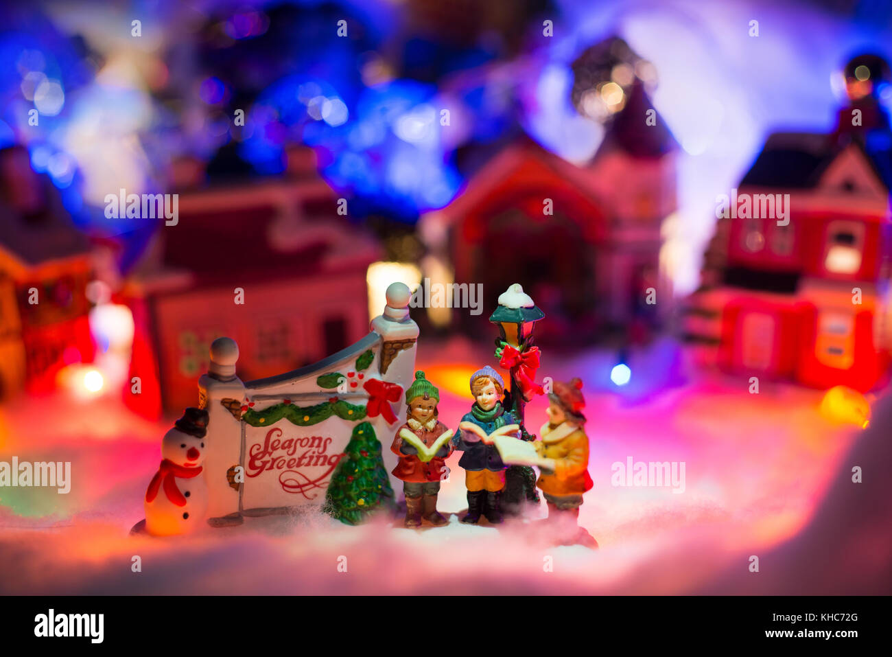 Christmas background with kids reading bible next to season greeting ...