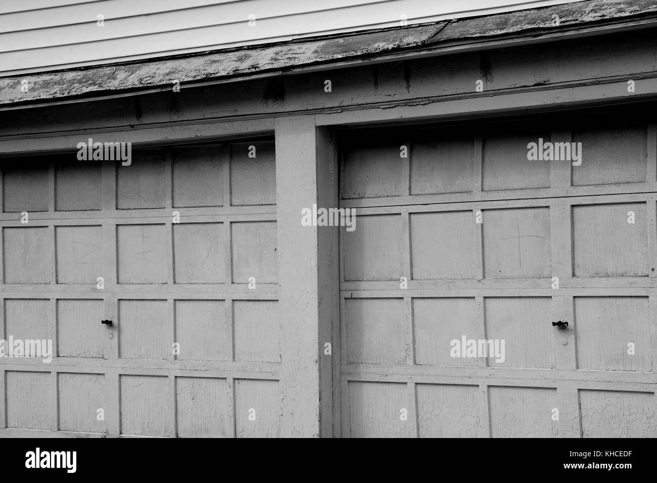 A Pair Of Old Garage Doors Along A Street In Martinsburg West Stock