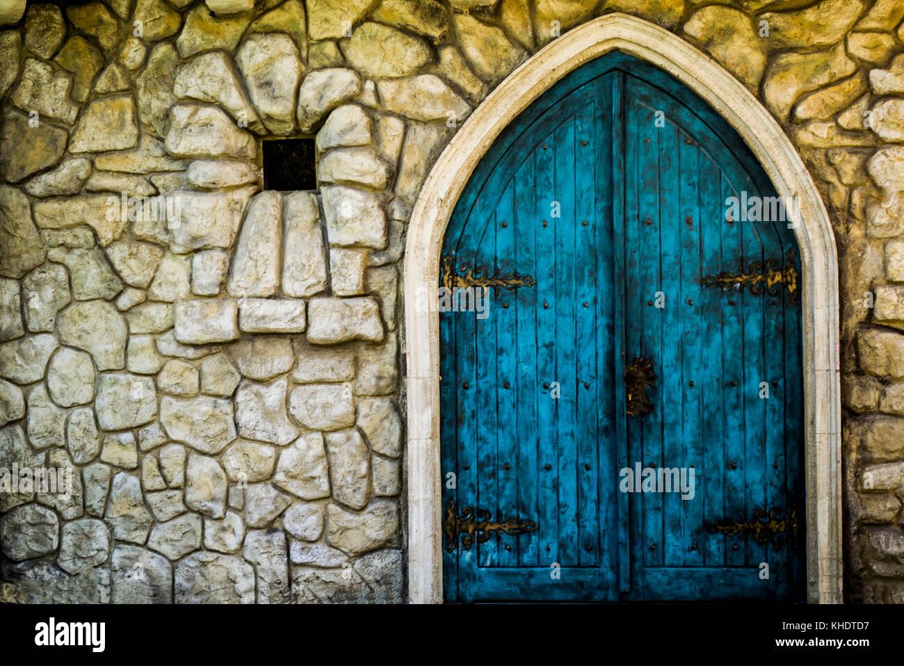A blue wooden castle door in a park for children Stock Photo ...
