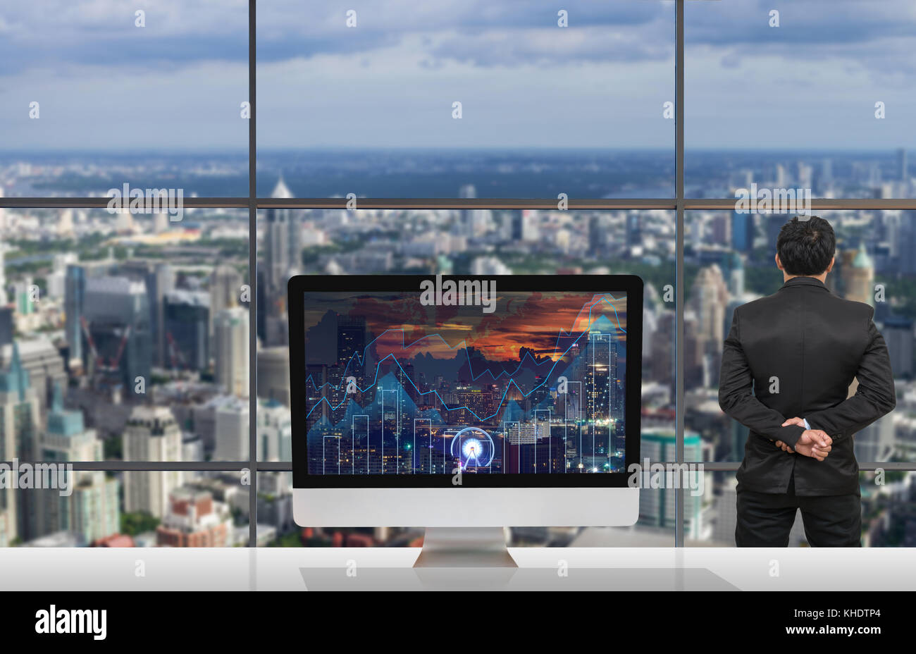 Back side of businessman looking at citiy out off windows glass with back side of businessman looking at citiy out off windows glass with computer show trading graph on the cityscape at night and world map background on gumiabroncs Gallery