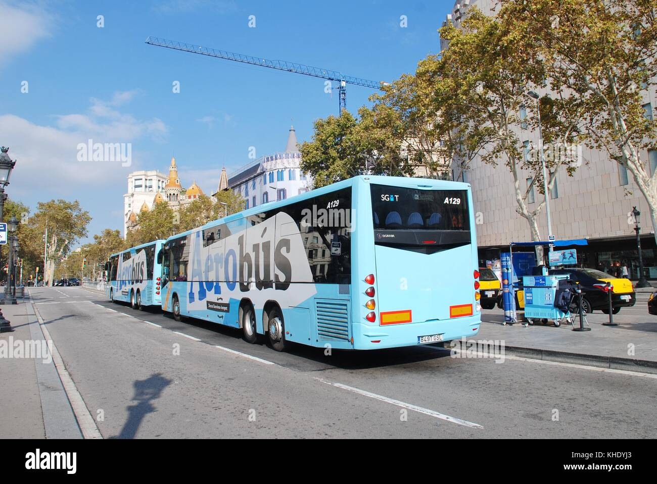 aerobus airport shuttle buses parked at their stop in the placa de cataluyna in barcelona