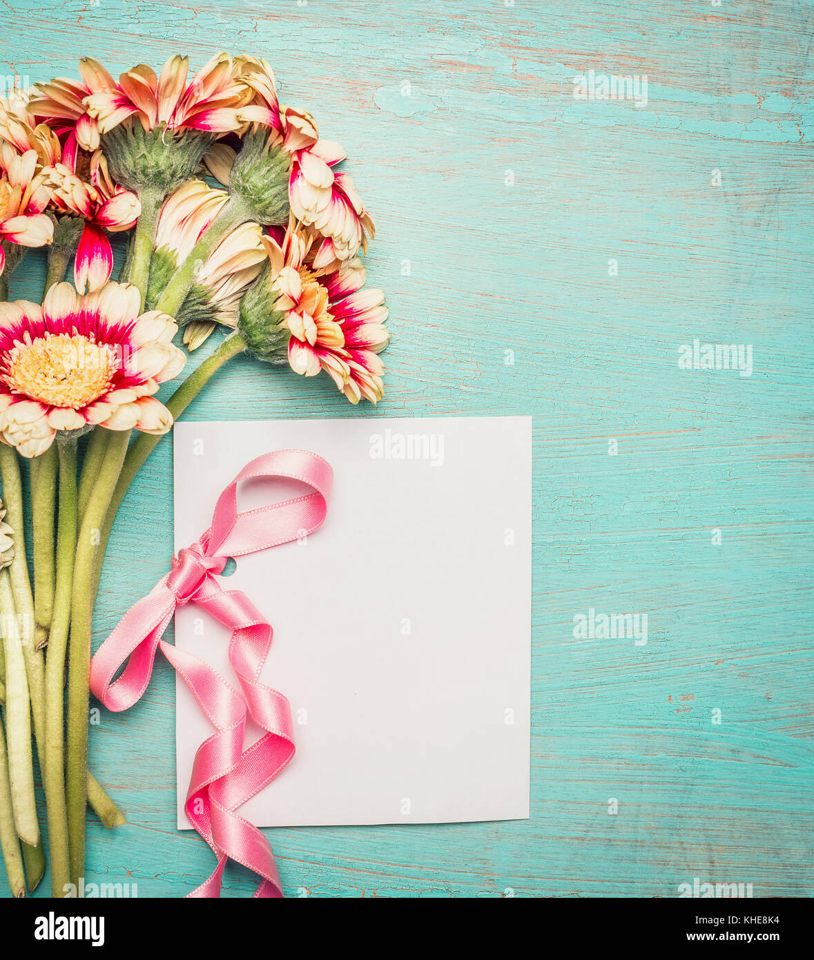 Flowers Bunch With Blank White Greeting Card And Pink Ribbon On