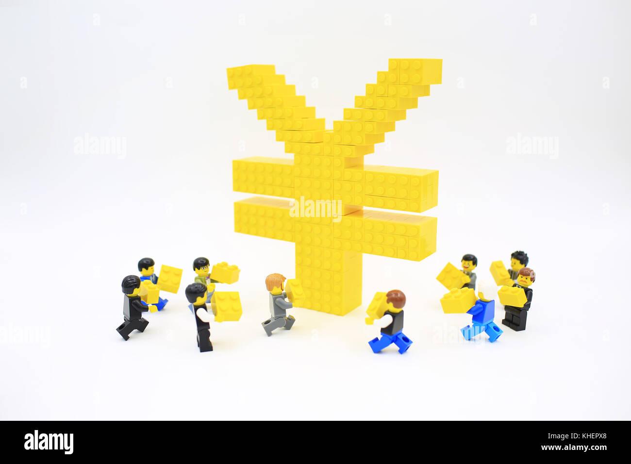 Japanese yen symbol stock photos japanese yen symbol stock yen japanese money with minifugure lego stock image biocorpaavc Choice Image