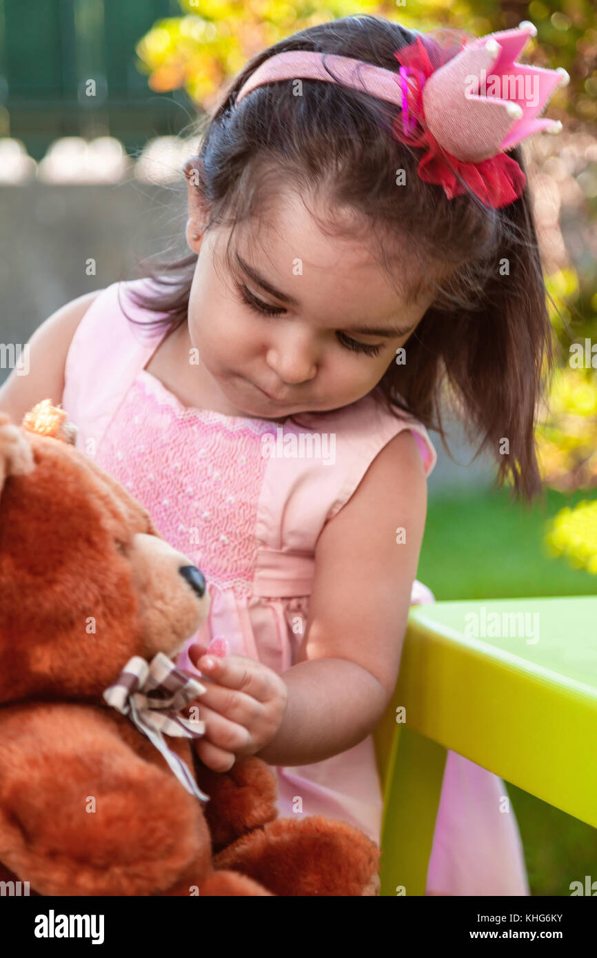 Baby toddler girl, playing in a tea party feeds best friend bff ...