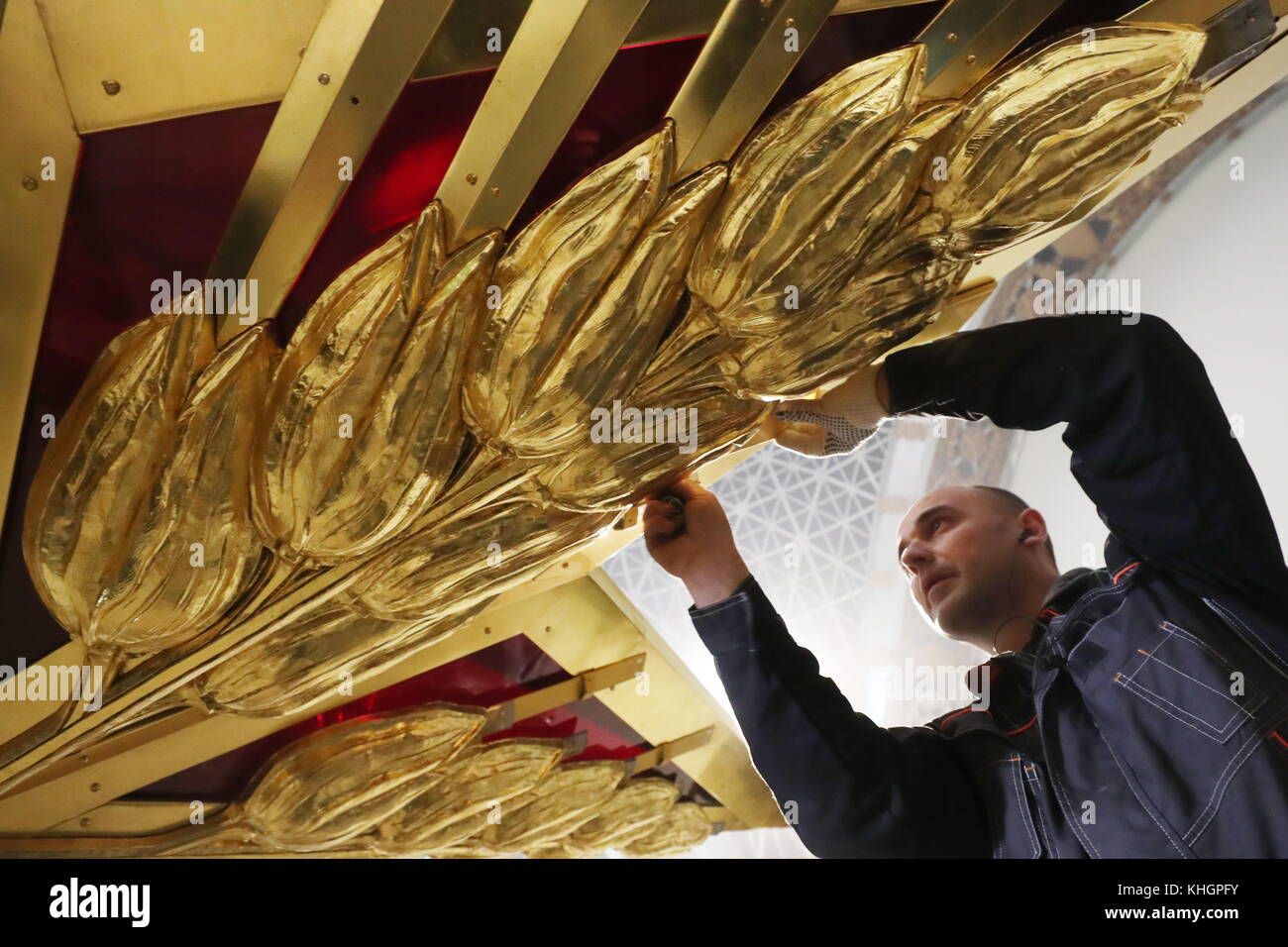 Moscow russia 17th nov 2017 a worker installing a star shaped a worker installing a star shaped chandelier at the cosmos pavilion of the vdnkh exhibition centre the chandelier is a replica of the star that had been aloadofball Image collections