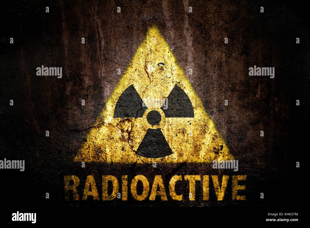 Yellow radioactive ionizing radiation danger symbol with word yellow radioactive ionizing radiation danger symbol with word radioactive painted below the sign on a massive concrete wall with dark rustic grunge buycottarizona Images