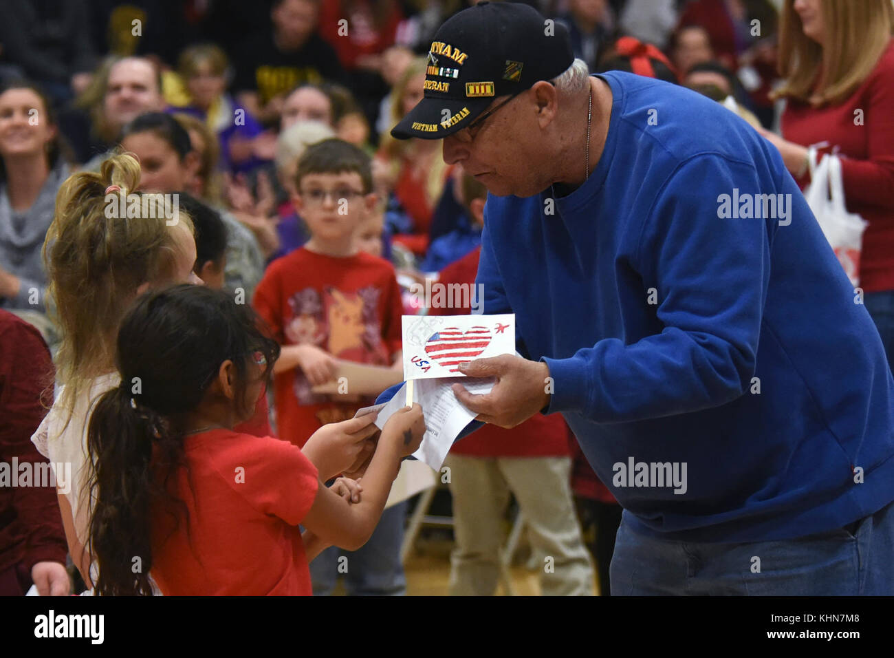 ellicott students give thank you letters and hand made flags to a vietnam veteran during the ellicott school district veterans day ceremony at ellicott