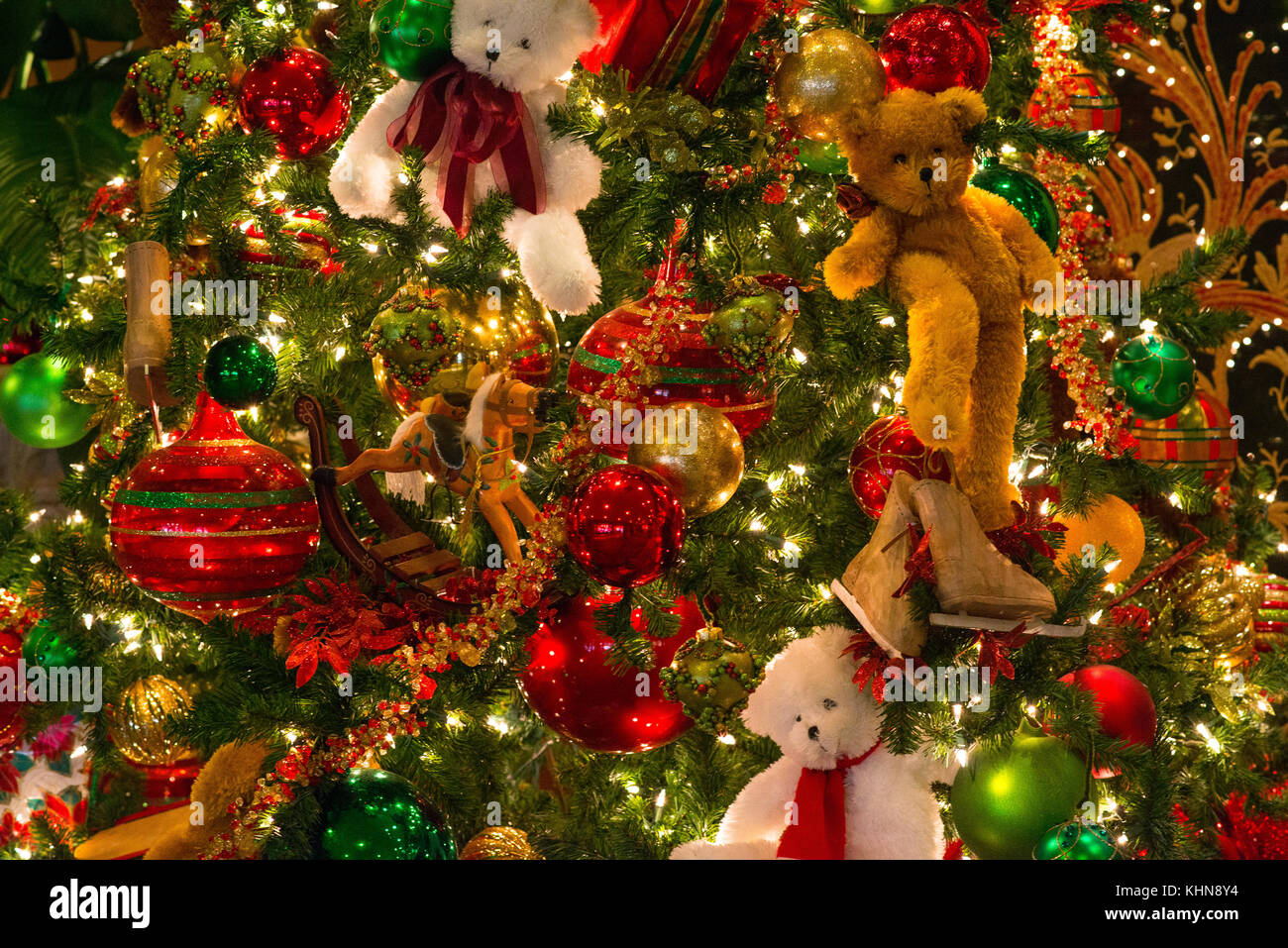 Christmas Texture Of Multi Colors Red Blue Green Golden Glitter Ornaments And Teddy Bears Placed Against The Backdrop Of Damask Pattern Wall