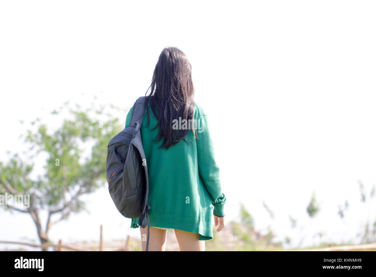 Straight perm edinburgh - Back View Of Woman With Black Long Perm Hair In Green Jacket Standing Alone On