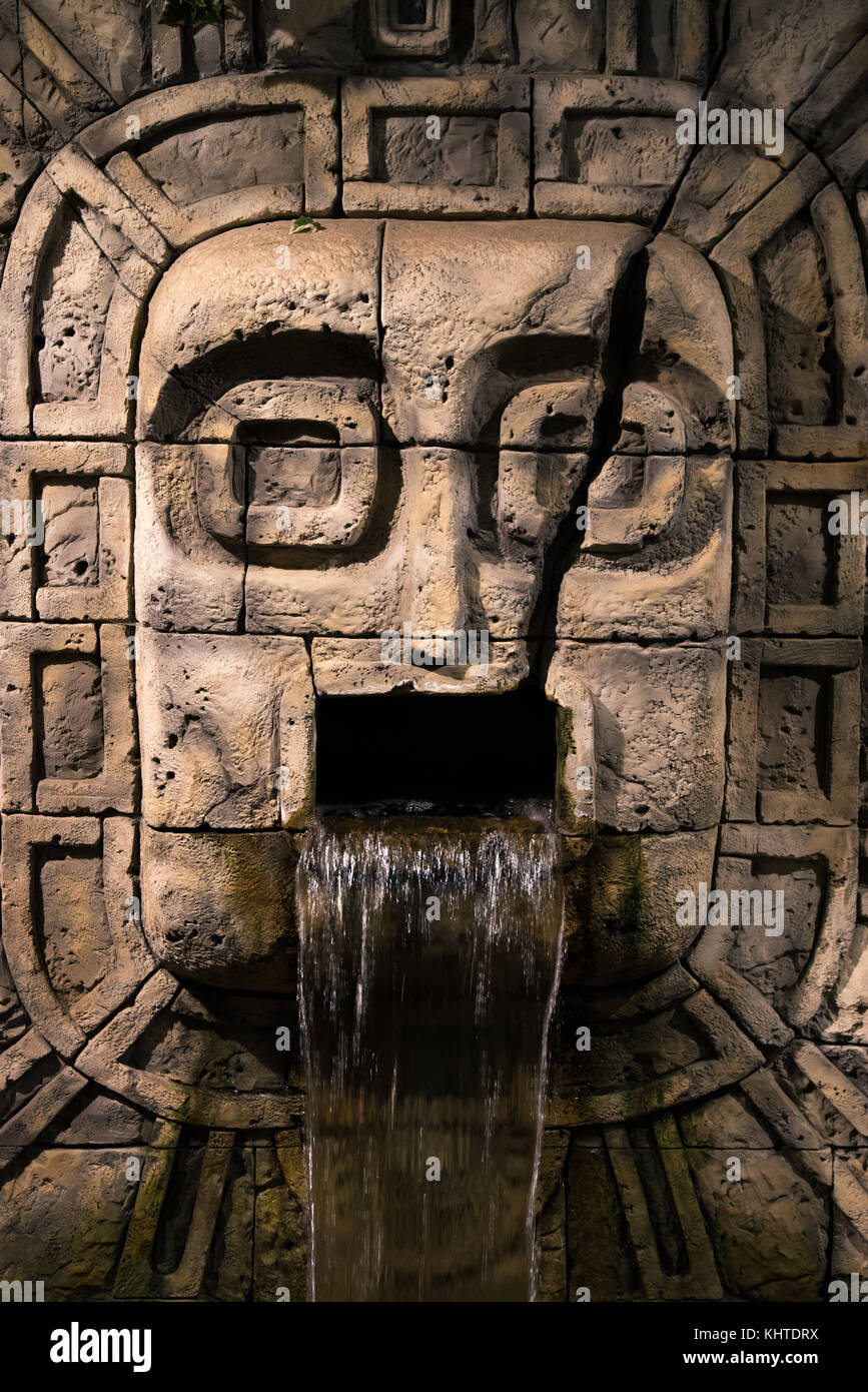Tribe Sign Made Of Stone Head With Small Waterfall Mexican Culture