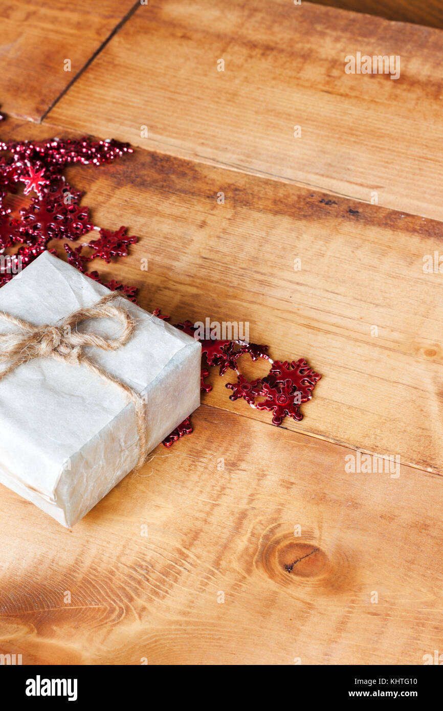 Small Christmas Handmade Gift Boxes On Wooden Background Stock Photo