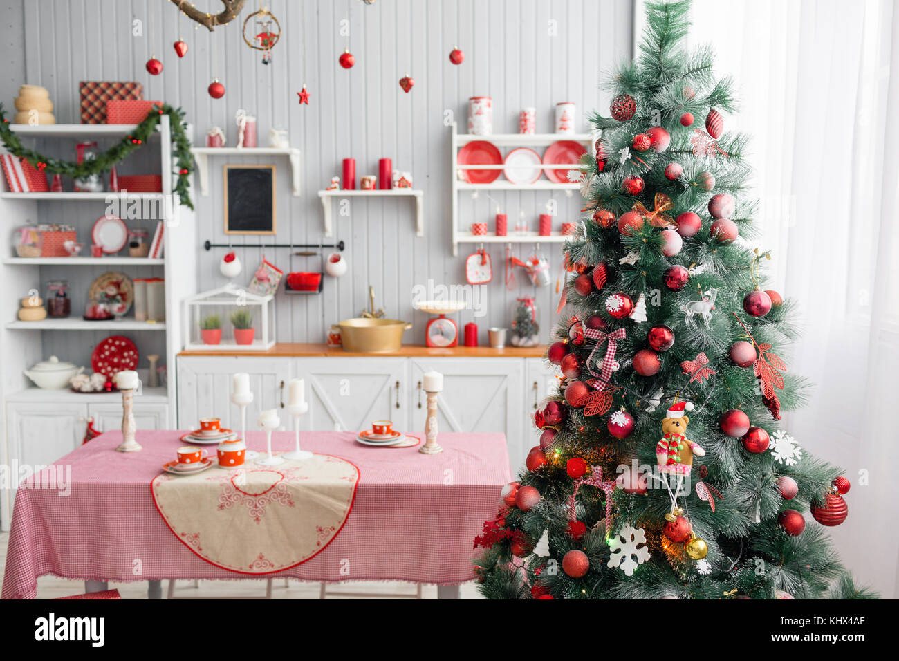 Interior light grey kitchen and red christmas decor. Preparing lunch ...